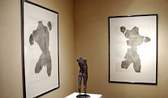 David Begbie Etchings of male torso figures together with a mesh sculpture at an exhibition