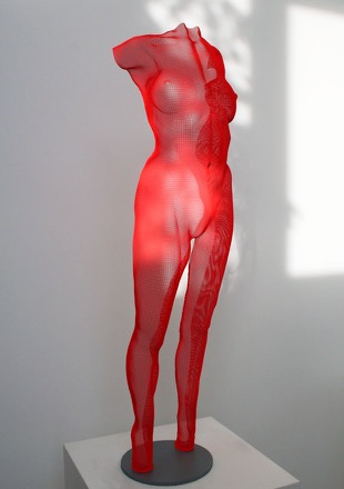 Red body sculpture of a girl - Feme by David Begbie