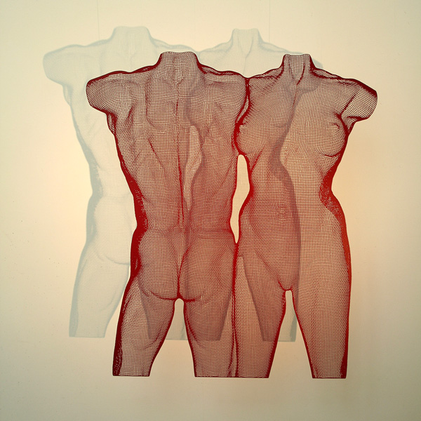 Red steel sculpture of two nude torsos VENII by artist David Begbie